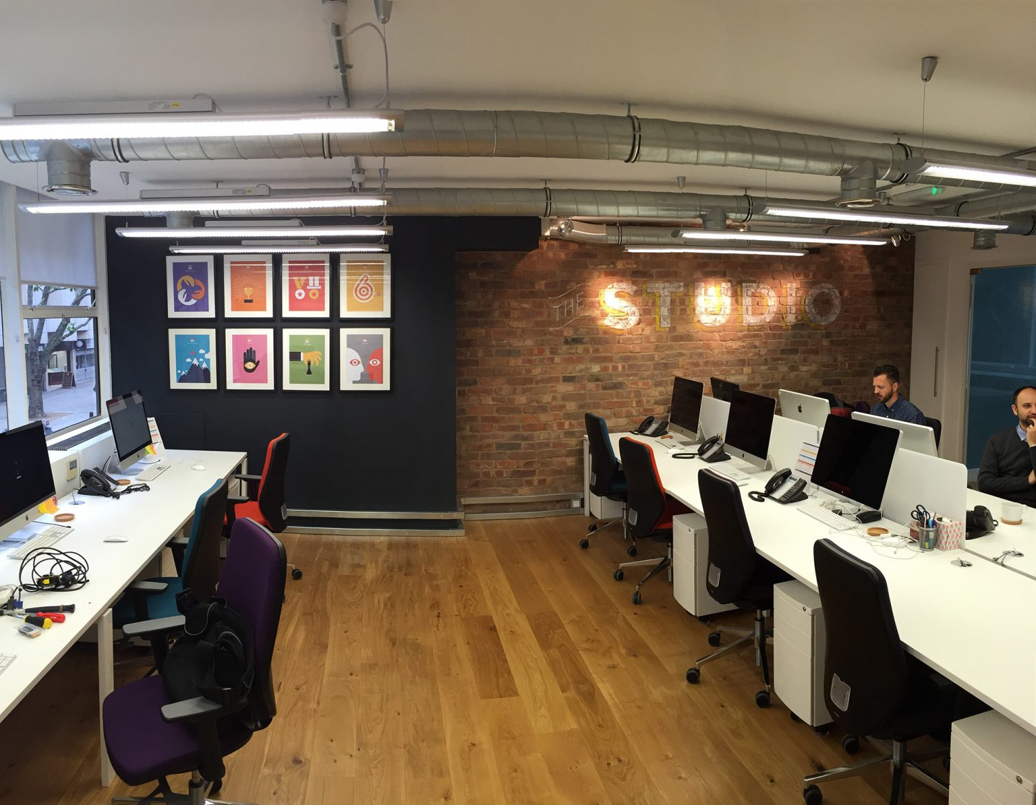 open plan office space with colourful images